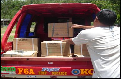 Loading textbooks for shipment to a difficult-to-reach elementary school